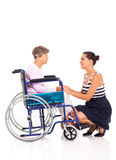Daughter disabled senior mother. Loving daughter talking to disabled senior mother on white background Stock Photography