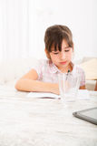 Daughter doing her homework Royalty Free Stock Photos