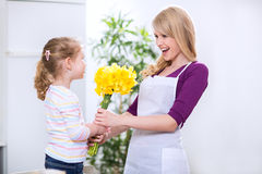 Daughter donates mother a bouquet of flowers for mother's day Stock Image