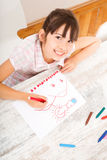 Daughter drawing at home Stock Photos