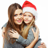 Daughter embrace  mother Christmas portrait. Royalty Free Stock Images