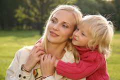 Daughter embraces the mother 2. Daughter embraces the mother on the meadow Royalty Free Stock Photo