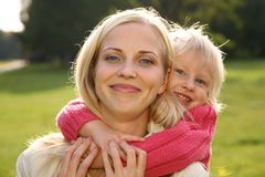 Daughter embraces the mother. Happy daughter embraces the mother Stock Photos