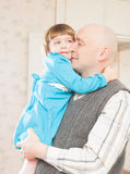 Daughter embracing dad royalty free stock photo