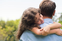 Daughter embracing father stock photos
