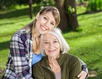 Daughter Embracing Mother At Campsite Stock Images