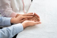 Free Daughter Encourage Mom, Young Aged People Holding Old Woman Hand, Mother Day Concept Stock Photography - 175144102