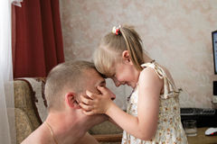 Daughter with father. The daughter plays with the father at home Royalty Free Stock Images