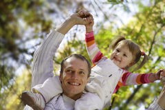 Daughter and father. In autumn park Royalty Free Stock Image
