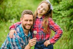 Daughter and father with dandelion. spring village country. ecology. Happy family day. little girl and happy man dad stock photography