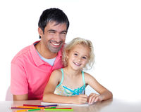 Daughter and father drawing looking at the camera Royalty Free Stock Photography
