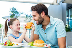 Daughter and father eating at the restaurant Royalty Free Stock Photography