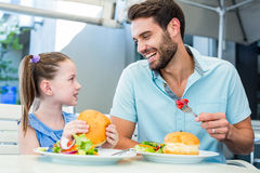 Daughter and father eating at the restaurant Royalty Free Stock Images