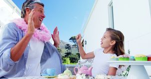 Daughter and father in fairy costume having fun 4k. Daughter and father in fairy costume having fun at garden 4k stock footage