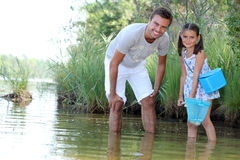 Daughter and father fishing Royalty Free Stock Photos