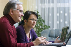Daughter and father on laptops Royalty Free Stock Photos