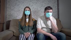 Daughter and father in masks