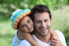 Daughter on Father's back Stock Photography