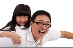 Daughter on  father's shoulders having fun Royalty Free Stock Image