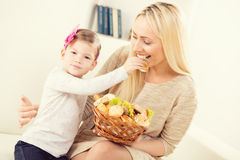 Daughter Feeding Mom Royalty Free Stock Photo