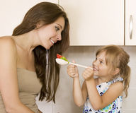 Daughter feeding mother - picture of mother and daughter eat hea. Lthy food Royalty Free Stock Images