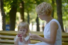 daughter focus mother park senior woman Στοκ Εικόνες