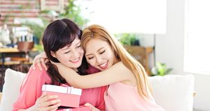 Daughter give her mother gift royalty free stock images