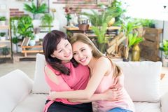 Daughter with her mother stock image