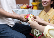Daughter give jasmine garland to father in fathers day royalty free stock image