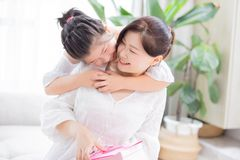 Daughter give mom a hug royalty free stock image