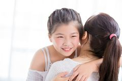 Daughter give mom a hug and smile stock photos