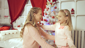 Daughter gives a gift to her mother for the new year Royalty Free Stock Image