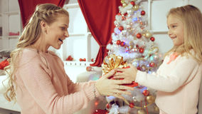 Daughter gives a gift to her mother for the new year Royalty Free Stock Photography