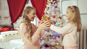 Daughter gives a gift to her mother for the new year Stock Image