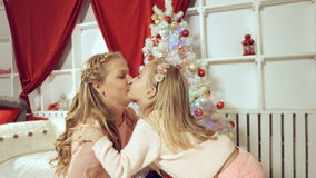 Daughter gives a gift to her mother for the new year Stock Photography