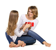 Daughter gives gift to mother Royalty Free Stock Photos