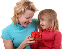 Daughter gives a gift to mum. On white background Stock Image