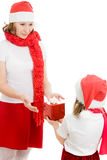 Daughter gives her mother a Christmas gift Royalty Free Stock Images