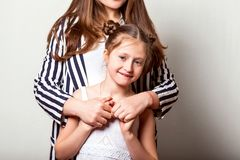 Daughter gives her mother flowers in the studio, happy mother`s. Day royalty free stock photo