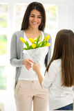 Daughter gives mom flowers Stock Images