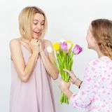 Daughter give mom flowers Royalty Free Stock Photos