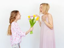 Daughter give mom flowers Stock Photo