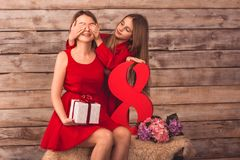 Daughter gives mom a gift stock image