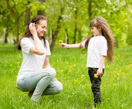 The daughter gives to mother a dandelion Royalty Free Stock Photo