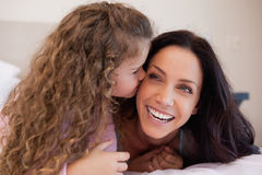 Daughter giving her mother a kiss on the cheek Stock Photography