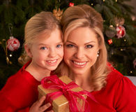 Daughter Giving Mother Christmas Gift Royalty Free Stock Images