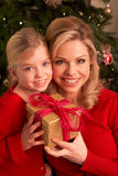 Daughter Giving Mother Christmas Gift Royalty Free Stock Photo