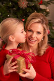 Daughter Giving Mother Christmas Gift Stock Photos
