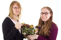 Daughter giving mother dried roses Royalty Free Stock Image