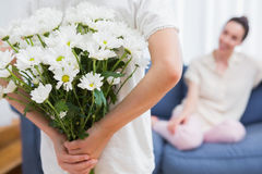 Daughter giving mother white bouquet Stock Photo